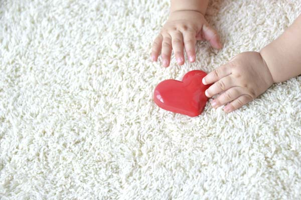 Baby playing on carpet